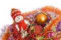 Christmas - Funny snowman and decoration tinsel Royalty Free Stock Photos