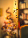 Christmas garland with a blury tree at the back Stock Photo