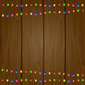 Christmas garland on wooden background with colored light bulbs illustration Stock Photos