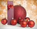 Christmas gift and baubles on golden background Royalty Free Stock Photo