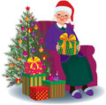 Christmas gift for the beloved granny elderly woman sitting in a chair with present in hands Royalty Free Stock Image