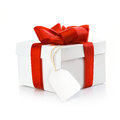 Christmas gift with blank tag Royalty Free Stock Photo
