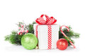 Christmas gift box, baubles and candy cane Royalty Free Stock Photo