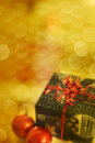 Christmas gift box and ornaments with golden holiday background Royalty Free Stock Images