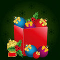 Christmas gift box with price tag, bows and balls Stock Photography
