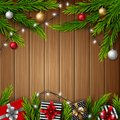 Christmas gift boxes with christmas balls and fir branches on bright wooden background Royalty Free Stock Photo