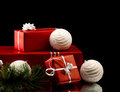 Christmas gift boxes and balls red with silver bright bow branch of firtree white on black background Royalty Free Stock Image
