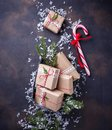 Christmas gift boxes and candy cane. Royalty Free Stock Photo