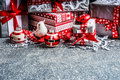 Christmas gift boxes with paper and red ribbons on gray rustic background side view Stock Images