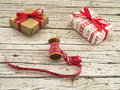 Christmas gift boxes and red ribbon on wooden background Royalty Free Stock Photo