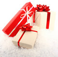 Christmas gift boxes on snow Stock Photos
