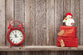 Christmas gift boxes, snowman and alarm clock Royalty Free Stock Photo