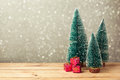 Christmas gift boxes under pine tree on wooden table over bokeh background Royalty Free Stock Photo