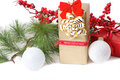 Christmas gift with branch firtree red Stock Photo