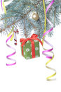 Christmas gift and decoration on fir tree branch Royalty Free Stock Images