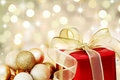 Christmas gift on defocused lights background Royalty Free Stock Photography