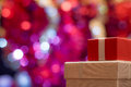 Christmas gift on defocused lights background Royalty Free Stock Photo