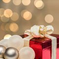 Christmas gift with defocused lights background. Royalty Free Stock Photo