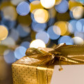 Christmas gift with label sparkling lights background Royalty Free Stock Photo