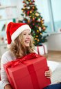 Christmas gift portrait of cheerful girl with big red giftbox on evening Royalty Free Stock Photos