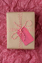 Christmas Gift on Red Tissue Royalty Free Stock Photo
