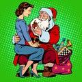 Christmas gift santa claus and a beautiful girl retro style pop art Royalty Free Stock Photos