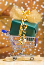 Christmas gift in shopping cart Royalty Free Stock Photo