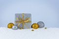 Christmas gift in the snow Royalty Free Stock Photo