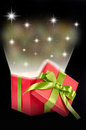 Christmas gift surprise box with light and stars Stock Photography