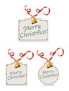 Christmas gift tags a set of with a gold bell and ribbon Royalty Free Stock Photos