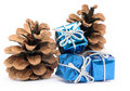 Christmas gifts on the background of spruce cones Royalty Free Stock Photo