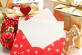 Christmas gifts and blank note Royalty Free Stock Photography