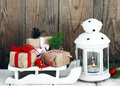 Christmas gifts and candle Royalty Free Stock Photo