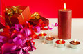Christmas gifts and four candles Royalty Free Stock Photo