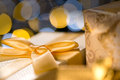 Christmas gifts gold wrapped in golden paper and ribbon Royalty Free Stock Photo