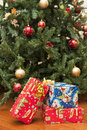 Christmas gifts the image depicts under a tree Royalty Free Stock Photo