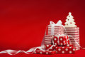 Christmas gifts with ribbon on a red background Stock Image