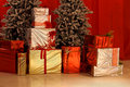 Christmas gifts under the tree inside home Stock Image