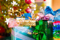 Christmas gifts under x-mas tree Royalty Free Stock Image