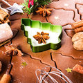 Christmas gingerbread baking background dough cookie cutters s spices and nuts festive food top view closeup Stock Image