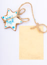 Christmas gingerbread cake star with icing and decoration and blank card homemade blue paper copy space on white as background Stock Photos