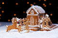 Christmas gingerbread cookie house and deers Royalty Free Stock Photo