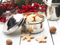 Christmas gingerbread cookies in a bowl with holly ornaments Royalty Free Stock Photography
