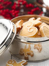 Christmas gingerbread cookies in a bowl with holly ornaments Royalty Free Stock Image