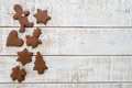 Christmas gingerbread cookies with different shapes over a white vintage wooden table Royalty Free Stock Photo