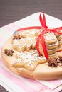 Christmas gingerbread cookies on wooden board round Stock Photos