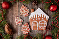 Christmas gingerbread house and fur tree cookies Royalty Free Stock Photo