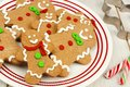 Christmas gingerbread man cookies on a plate close up group of Stock Images