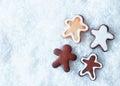 Christmas gingerbread men on snow Stock Photo