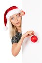 Christmas girl with billboard looking surprised isolated on white background Royalty Free Stock Photo